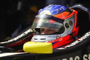 Bild Rennfahrer im Cockpit eines Rennautos
